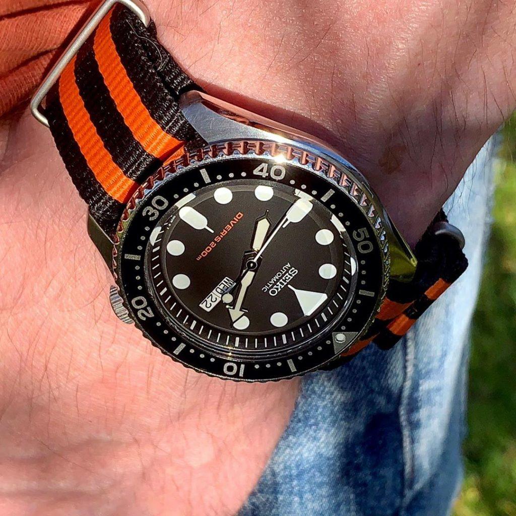 SKX007 on a orange and black NATO strap
