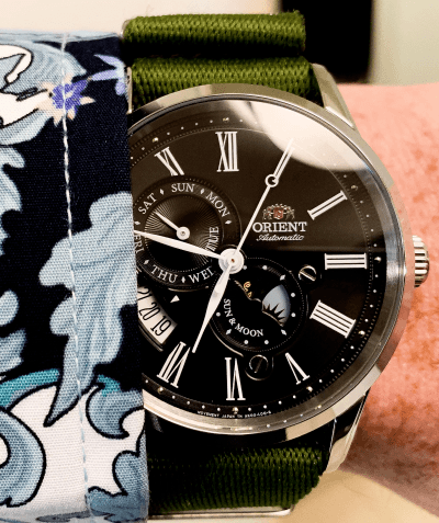 Orient Sun and Moon reflective black dial